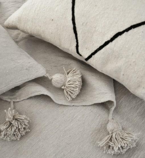 witte pom pom deken